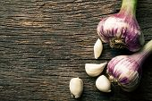 top view of fresh garlic on old wooden table