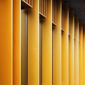 Abstract Architecture Fragment With Yellow Metal Facade And Windows