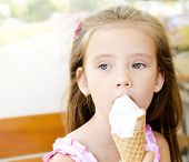 Thoughtful Little Girl Eating Ice Cream