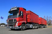 Red Volvo Fh Truck With Full Trailer And Blue Sky