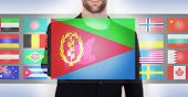 stock photo of eritrea  - Hand pushing on a touch screen interface choosing language or country Eritrea - JPG