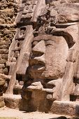 stock photo of mayan  - Detailed section from the temple of the mask Mayan ruins at Lamanai Belize - JPG