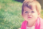 Adorable little girl taken closeup outdoors in summer - instagram effect