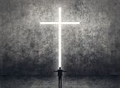 Silhouette of businessman stand in front of the cross light on the wall.