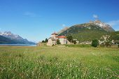 stock photo of engadine  - View of the lake Silvaplana a castle in the Swiss Alps - JPG