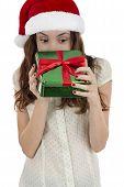 Christmas Woman Looking Into Gift Box