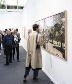People looking at a photo at Paris Photo art fair 2014, Paris, France