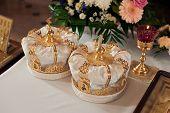 Two beautiful wedding crowns in church
