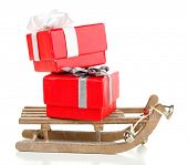 Wooden toy sledge with Christmas gifts, isolated on white