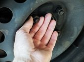 Person Checking Rusty Nuts Steel Wheel