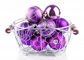 Beautiful Christmas balls in metal basket isolated on white