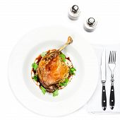 Glazed Christmas Roast Duck Seasoned With Oil, Herbs, Fig And Aniseed Sauce In A White Plate
