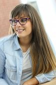 Portrait of student girl wearing eyeglasses in class