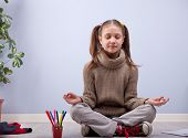 pic of girlie  - little girl meditating instead of making her homework - JPG