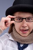 Girl Stucking Out Her Tongue With Glasses And Hat