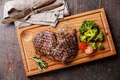 Medium Rare Grilled Beef Steak Ribeye With Broccoli On Cutting Board On Wooden Background