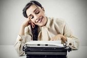 Happy woman typing a letter