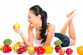 Asian Chinese woman eating fresh fruit
