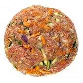 Healthy hamburger patty, isolated on white.  Raw beef mixed with grated vegetables, including carrot and zucchini or courgette.