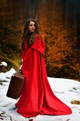 pic of cloak  - beautiful woman with red cloak and suitcase alone in the woods - JPG
