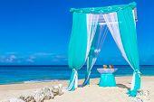 beautiful wedding arch on tropical sand beach, outdoor beach wedding set up