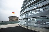 BERLIN, GERMANY - NOV 15, 2014: People visit the modern dome on the roof of the Reichstag. It is a glass dome constructed on top of rebuilt Reichstag - Germany's parliament building.