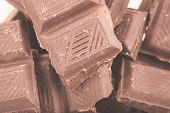 Pieces of milk chocolate closeup. Macro photo