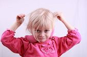 Little blonde girl in a pink dress