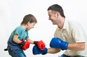 kid boy and dad play boxing