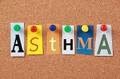 image of asthma  - The word Asthma in cut out magazine letters pinned to a corkboard - JPG