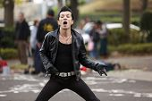 TOKYO, JAPAN, NOVEMBER 27, 2011: A rockabilly rebel is performing dance in the Harajuku park. The Rebels band is very famous in Tokyo for their street show. Tokyo, Japan