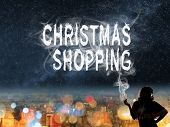 Christmas concept of  shopping to buy with Asian lady and smoke text in the city night.