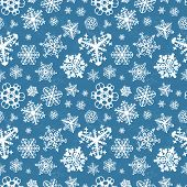 Different modern snowflakes on blue background seamless pattern