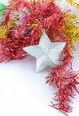 Christmas Decoration With Silver Star And Artificial Fir Branch