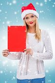 Beautiful woman with santa hat holding a red paper without subtitles