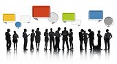 Silhouettes of Discussing Business People with Speech Bubbles