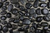 Black granite stones background for concepts.