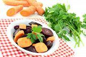 Fresh Crisp Orange And Purple Carrots