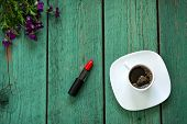 picture of violets  - Red Lipstick and cup of coffee on wooden table decorated violet flowers and berries - JPG