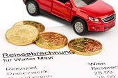 a settlement of travel expenses with car and euro coins