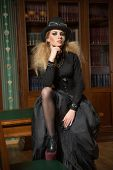image of gothic girl  - Vintage sexy girl next to the bookcase - JPG