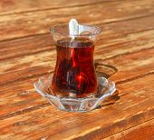 picture of vibration plate  - Traditional Turkish glass of tea on wooden table outdoor servise - JPG