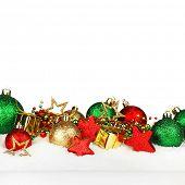 Beautiful various christmas decor on snow close-up