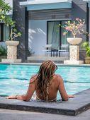 Young woman in bikini at the swimming pool in Bali Indonesia