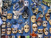 foto of cultural artifacts  - Group of theatrical masks on blue wall - JPG