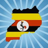 Uganda map flag on blue sunburst illustration
