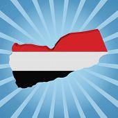 Yemen map flag on blue sunburst illustration