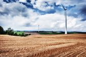 Country Landscape With Wind Turbines