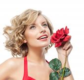 portrait of attractive  caucasian smiling young woman blond isolated on white studio shot with rose  flower red dress