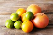 Lots ripe citrus on wooden background